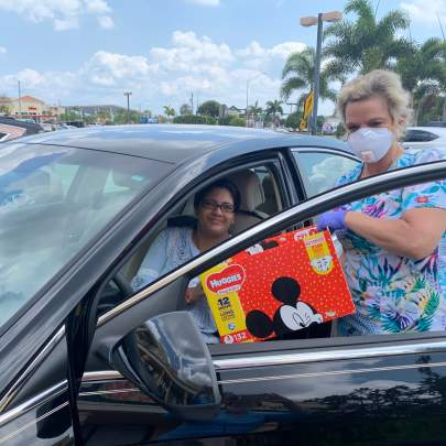 Photos by Beverly Jones:  Lisa Kieffer, pre-natal outreach manager with Martin County Healthy Start Coalition meets client Kushboo Bohia in the parking lot with  formula for her infant.